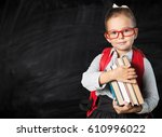 child with book. | Shutterstock . vector #610996022