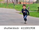 Happy Boy Play And Running At...