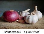 Red Onion And Garlic On Dark...