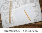 open blueprints on wooden table ... | Shutterstock . vector #611037926