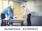 architects  engineers and... | Shutterstock . vector #611054612