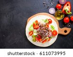 tacos with vegetables and meat... | Shutterstock . vector #611073995
