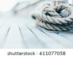 rope on a yacht with wooden details - stock photo
