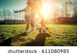 father and son playing together ... | Shutterstock . vector #611080985