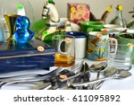 Small photo of Garage sale yard sale old unwanted items and utensils.
