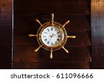 gold wall clock as the helm of... | Shutterstock . vector #611096666