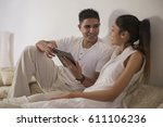 singapore  young man and woman... | Shutterstock . vector #611106236