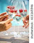 people hold champagne glasses... | Shutterstock . vector #611165546