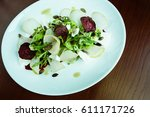 salad with arugula  pear ... | Shutterstock . vector #611171726