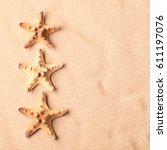 Three Sea Starfish On Beach...