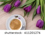 purple tulips and coffee in... | Shutterstock . vector #611201276