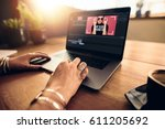 woman editing video on laptop... | Shutterstock . vector #611205692