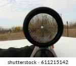 Small photo of The gun aimed at a target . Magnum airgun