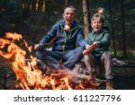 father and son overroast their... | Shutterstock . vector #611227796