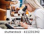 young woman repairing computer...   Shutterstock . vector #611231342