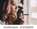 beautiful girl smoking cannabis ... | Shutterstock . vector #611236826