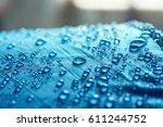 rain water droplets on  blue... | Shutterstock . vector #611244752