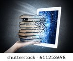 reading books with an e book   Shutterstock . vector #611253698