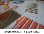 many charts and graphs with pen ... | Shutterstock . vector #611257352