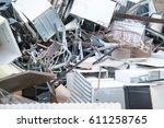 piles of scrap metal outside | Shutterstock . vector #611258765
