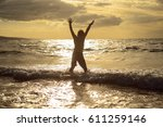 silhouette of boy with open... | Shutterstock . vector #611259146