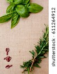 sprigs of rosemary and basil on ...   Shutterstock . vector #611264912