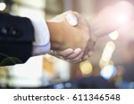 handshaking business meeting... | Shutterstock . vector #611346548