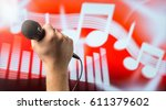 man holding microphone in front ... | Shutterstock . vector #611379602