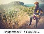 tourist young woman wearing hat ... | Shutterstock . vector #611393012