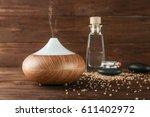 aroma oil diffuser on wooden... | Shutterstock . vector #611402972