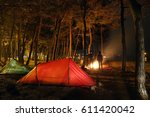 Campfire And Tents While Peopl...