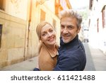 middle aged couple walking in... | Shutterstock . vector #611421488