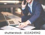 handsome businessman in suit... | Shutterstock . vector #611424542