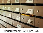 mail boxes filled of leaflets... | Shutterstock . vector #611425268