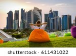 woman sitting on a bean bag in... | Shutterstock . vector #611431022