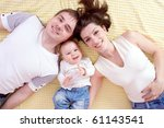 happy family plays in the bed | Shutterstock . vector #61143541