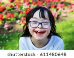 portrait of little girl smiling ... | Shutterstock . vector #611480648