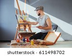 artist painting a picture in a... | Shutterstock . vector #611498702
