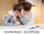 older sister helps younger... | Shutterstock . vector #611499266