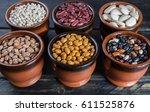 assortment of beans on black... | Shutterstock . vector #611525876