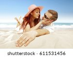summer time on beach and two... | Shutterstock . vector #611531456