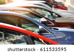 group of cars parked in a row  | Shutterstock . vector #611533595