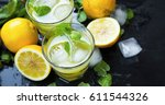 lemon cocktails with mint and... | Shutterstock . vector #611544326