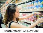 young asian woman shopping... | Shutterstock . vector #611691902