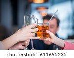 company celebrates victory.... | Shutterstock . vector #611695235