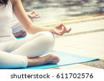 woman with meditation at pool | Shutterstock . vector #611702576
