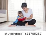 asian chinese mother and... | Shutterstock . vector #611705252