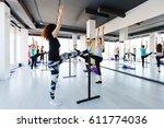 young women doing stretching... | Shutterstock . vector #611774036