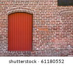 Red Brick Wall With A Red Door...