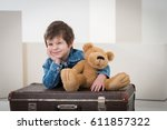 little boy sitting on the... | Shutterstock . vector #611857322